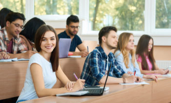 young-student-looking-at-camera-sitting-in-the-university_7502-1107